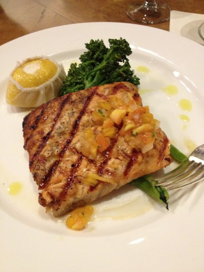Grilled salmon, tomato chutney, and broccolini in the Bellagio.